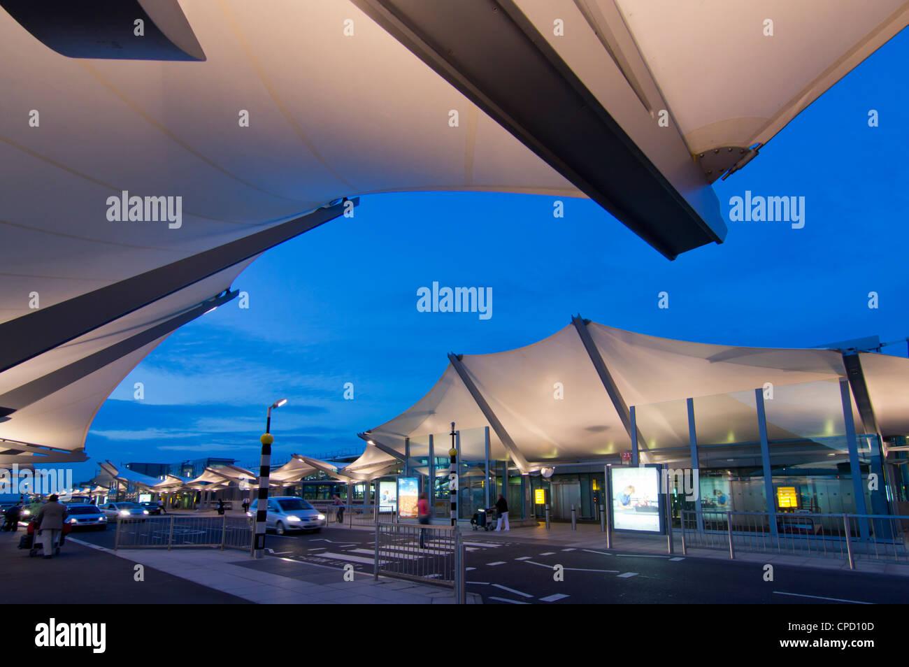 Heathrow Airport Terminal 5 at dusk, London, England, United Kingdom, Europe - Stock Image