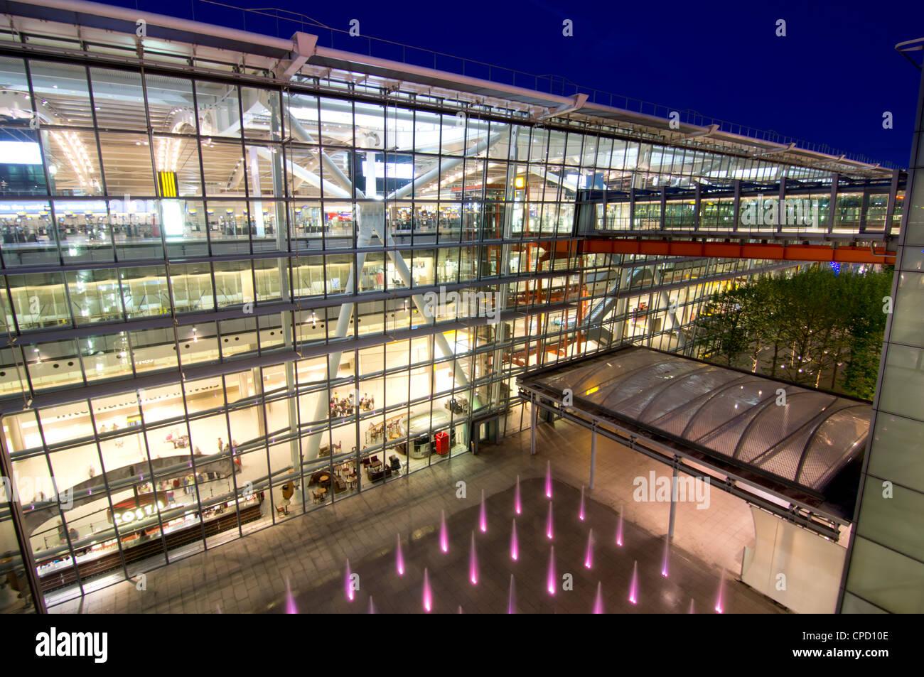 Heathrow Airport Terminal 5 building at dusk, London, England, United Kingdom, Europe - Stock Image