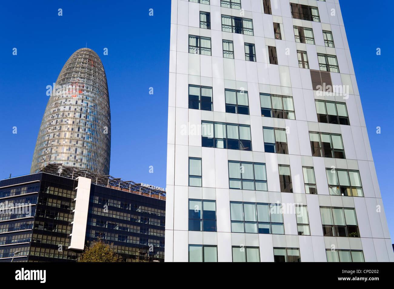 Torre Agbar skyscraper and Novotel Hotel on Avenue Diagonal, Barcelona, Catalonia, Spain, Europe - Stock Image