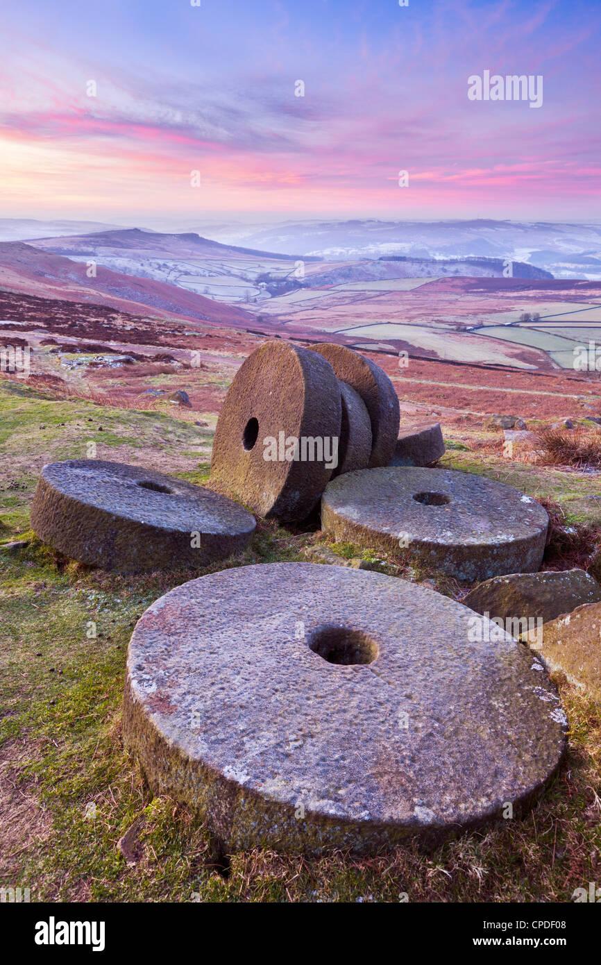 Stanage Edge wheelstones (millstones) and frosty winter moorland sunrise, Peak District National Park, Derbyshire, - Stock Image
