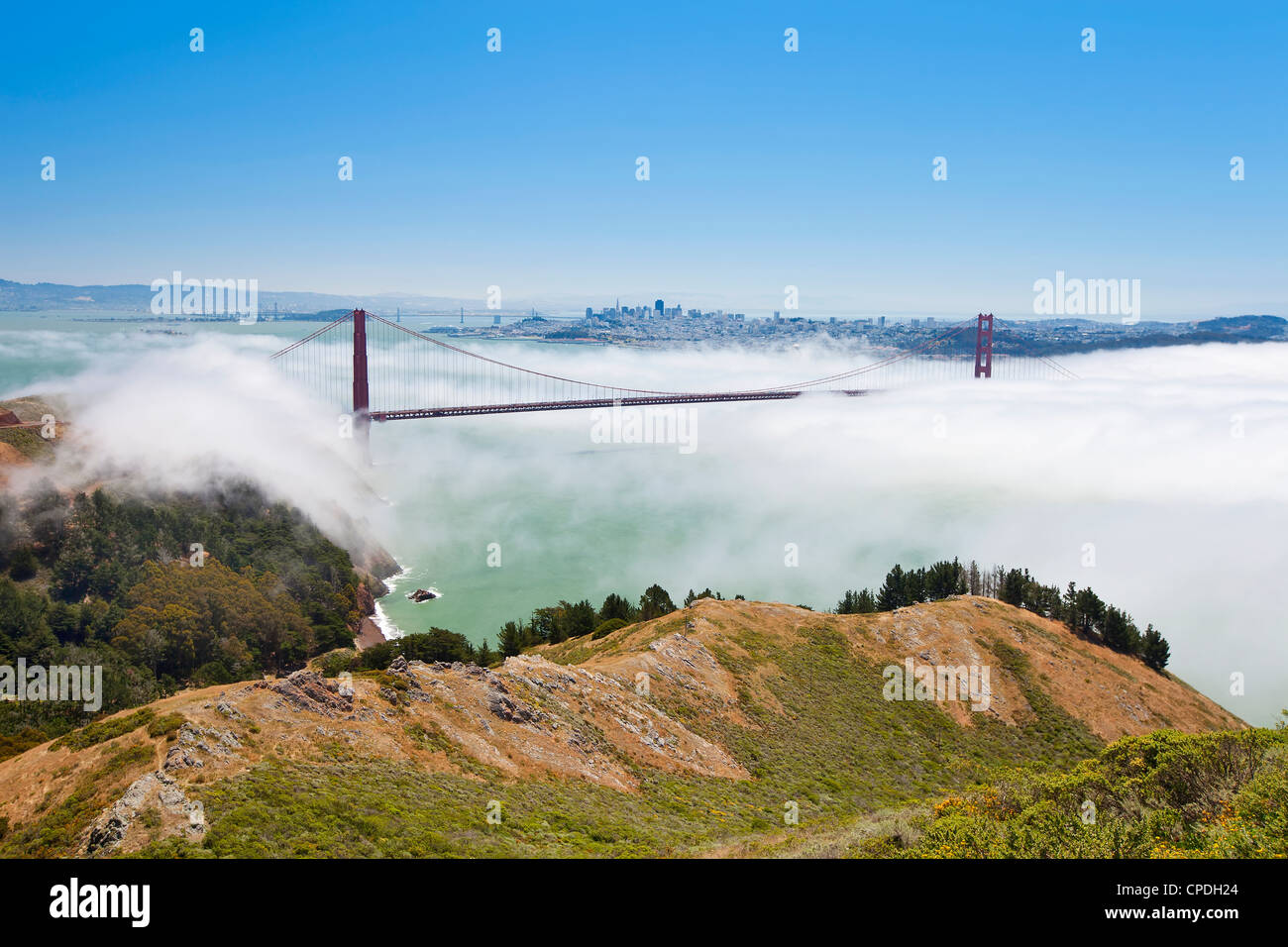 Golden Gate Bridge and the San Francisco skyline floating above the fog on a foggy day in San Francisco, California, - Stock Image