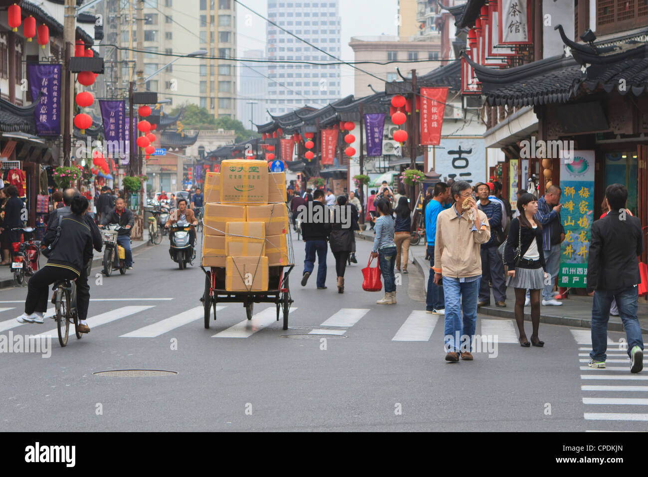 Pedestrians and traffic on Shanghai Old Street, remnant of a bygone age, Fuxing, Shanghai, China, Asia - Stock Image