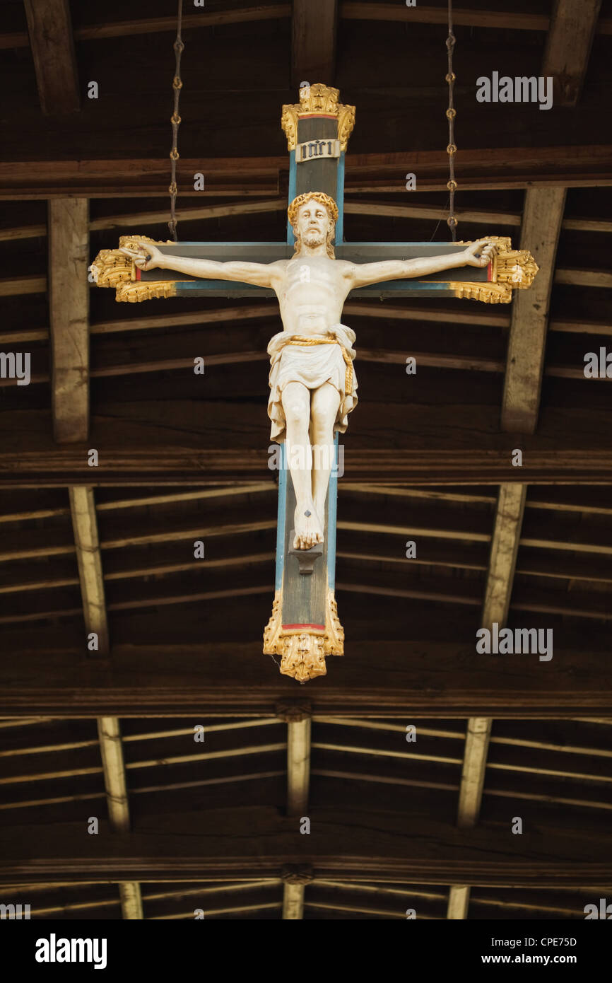 A statue of Jesus on the cross hanging from the ceiling of