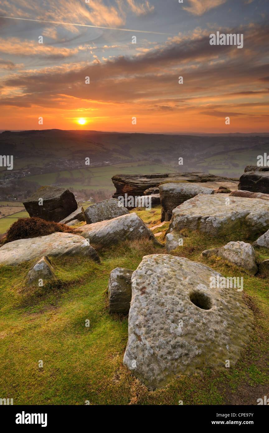 Sunset over millstones, Froggatt and Curbar Edge, Peak District National Park, Derbyshire, England, United Kingdom, - Stock Image