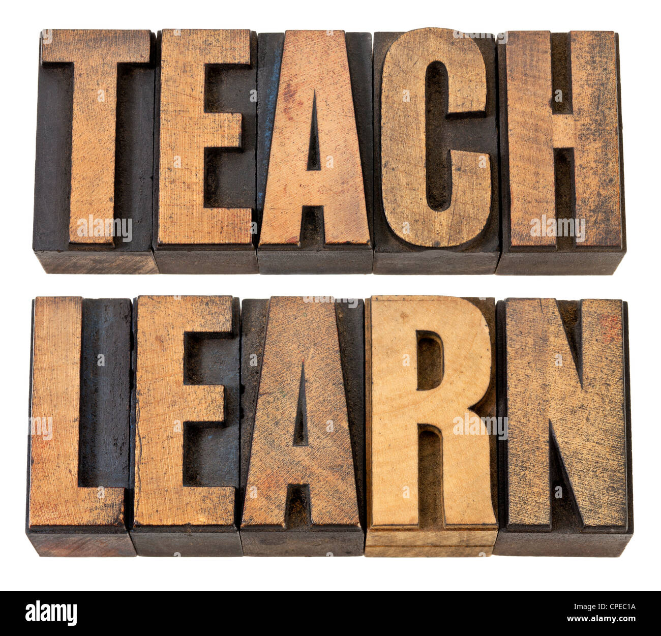 teach and learn - education concept - isolated words in vintage letterpress wood type - Stock Image