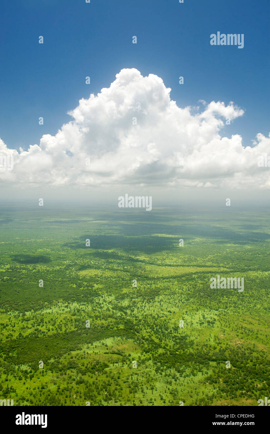 Aerial view of clouds over the coastal plains of northern Mozambique. - Stock Image