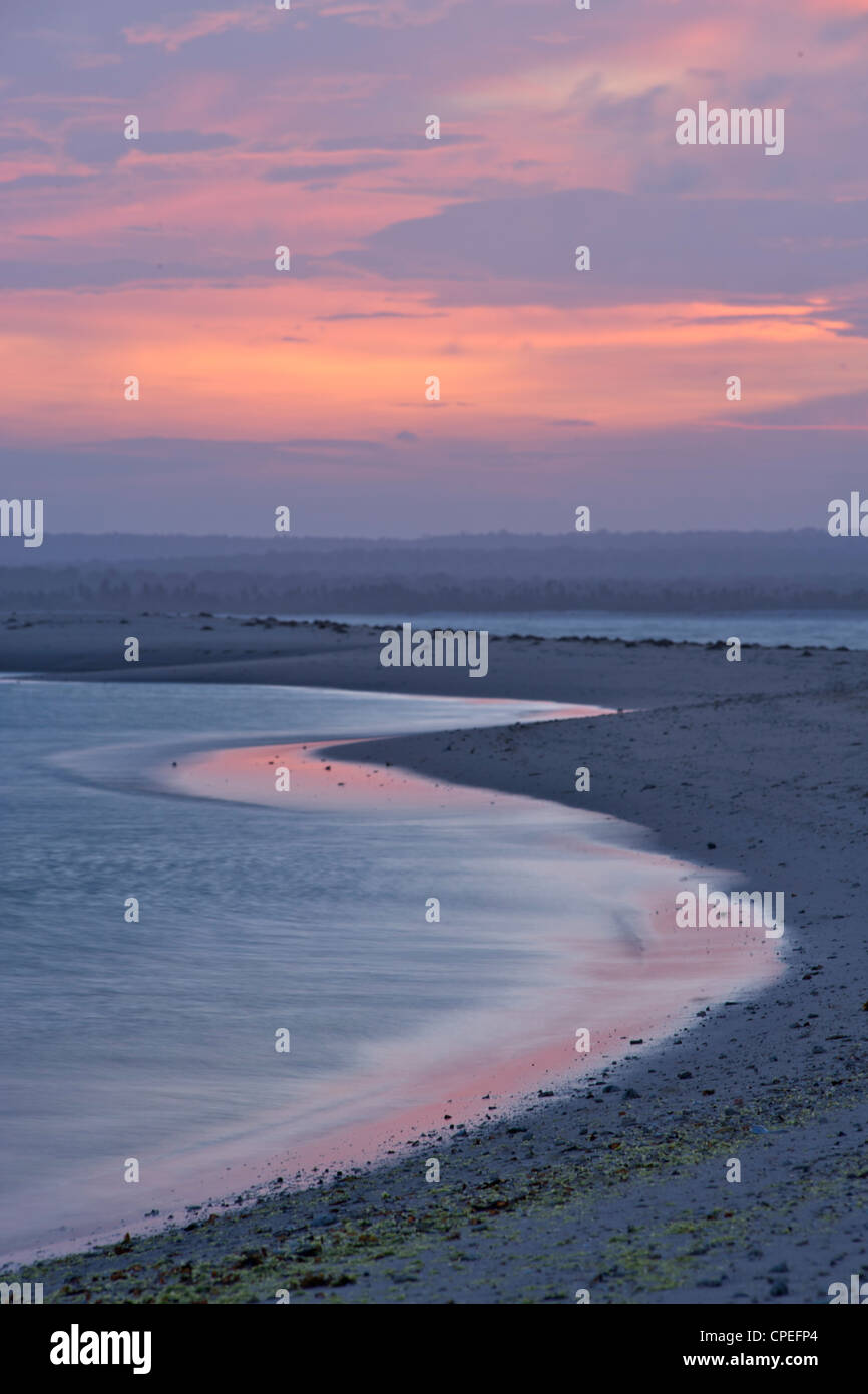 Sunset over Mogundula island in the Quirimbas archipelago in northern Mozambique. - Stock Image
