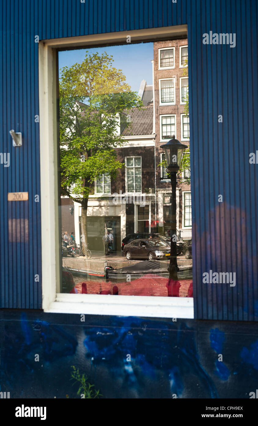 Reflection of buildings in glass Amsterdam, Netherlands, Holland - Stock Image