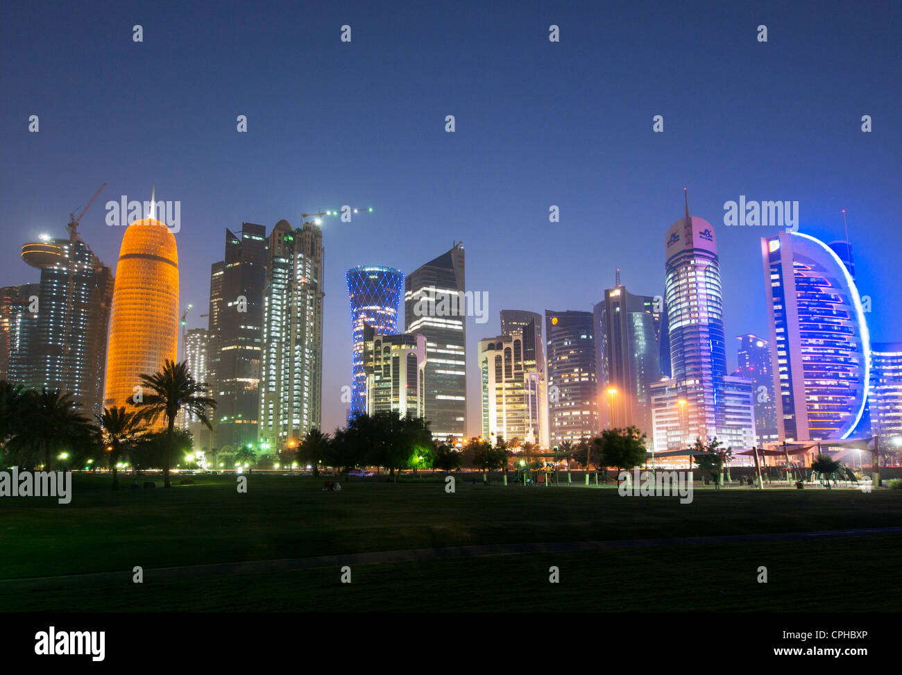Evening view of modern skyscrapers  at night on The Corniche  in new business district of Doha in Qatar - Stock Image