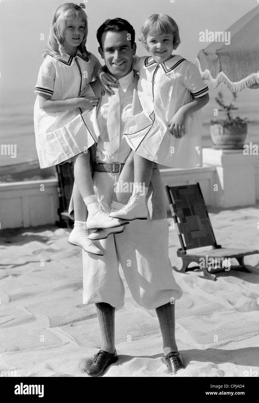 Harold Lloyd with his daughters, 1932 - Stock Image