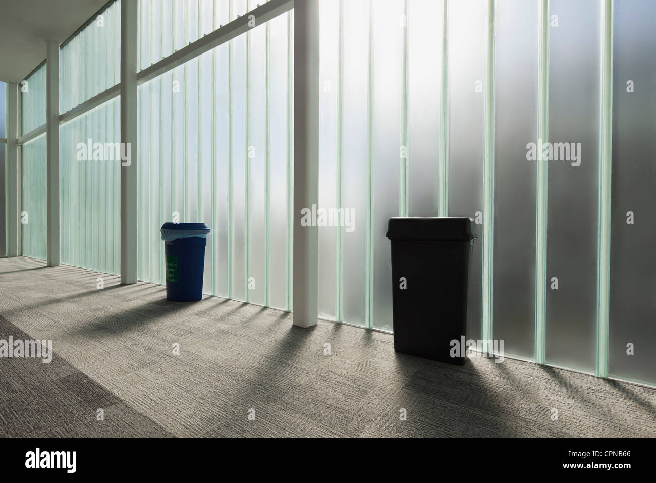 Modern lobby with glass wall - Stock Image