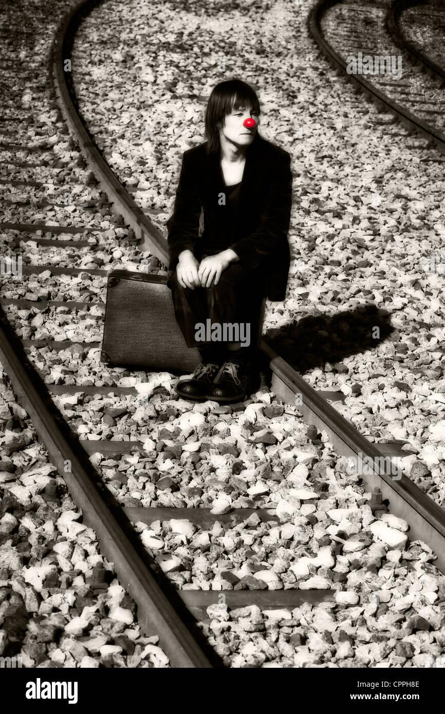 the sad clown on train tracks - Stock Image