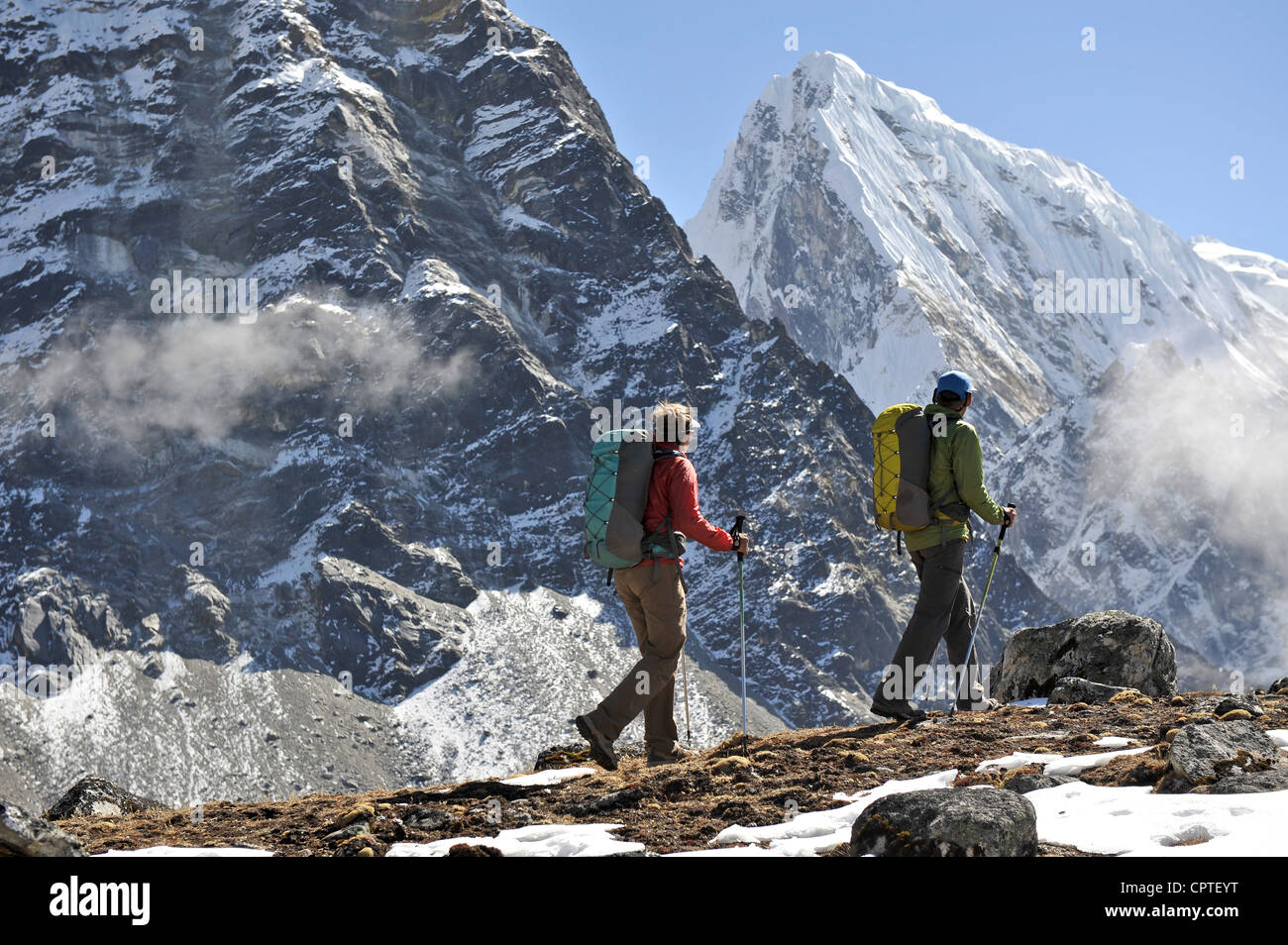 Trekkers hiking along a ridge, Gokyo, Nepal - Stock Image