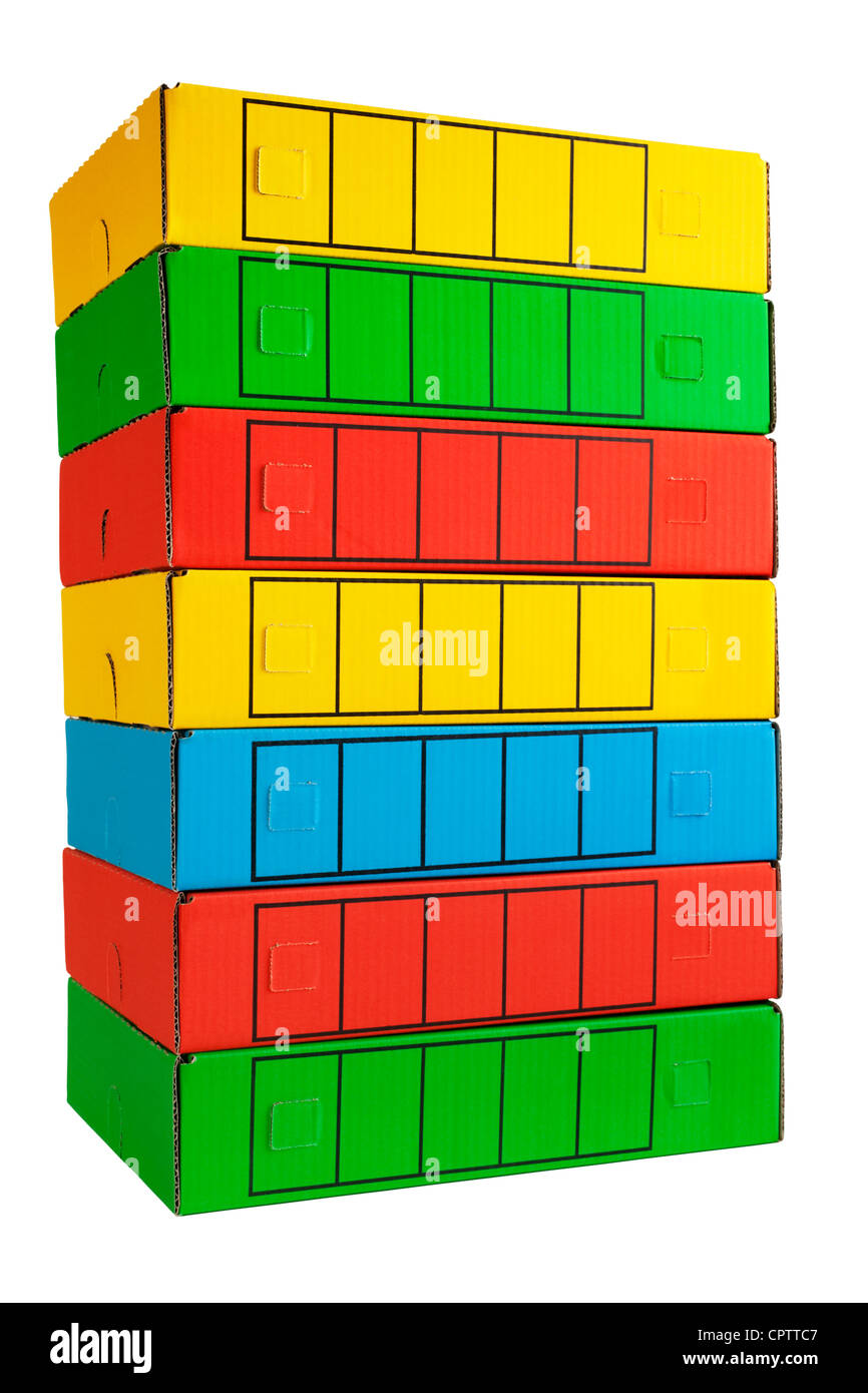 A pile of archive boxes in bright colours. Small shadow at base. - Stock Image