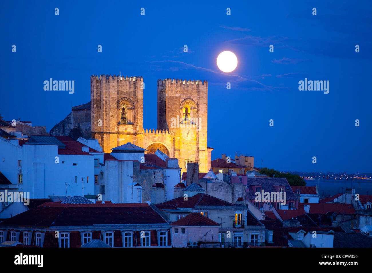 Patriarchal Cathedral of St. Mary Major, Lisbon, Portugal at twilight with moon rise - Stock Image