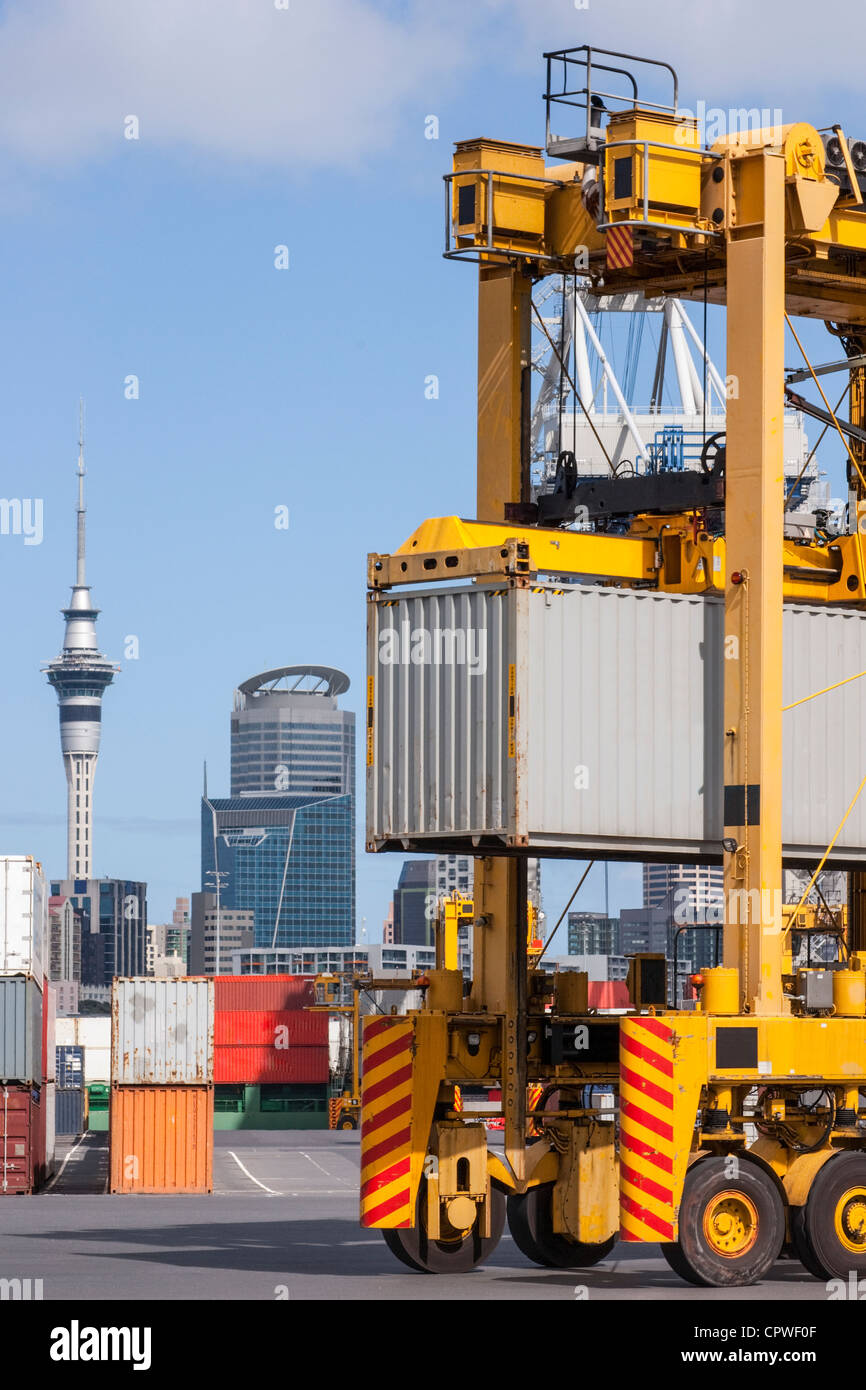 A straddle carrier moving a shipping container on the wharf in the Port of Auckland, - Stock Image
