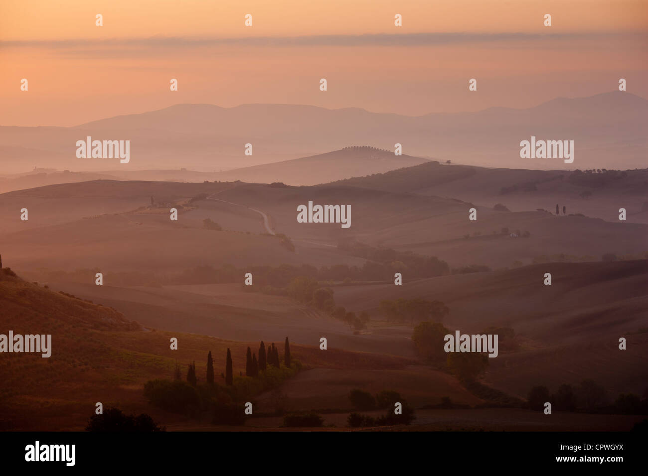 Tuscan landscape of hill slopes in Val D'Orcia, Tuscany, Italy - Stock Image