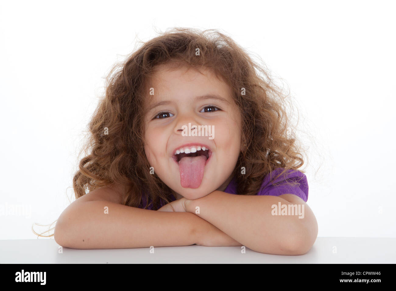 cheeky child sticking thumb out. - Stock Image