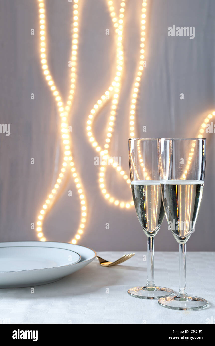 Glasses of champagne on table at an event - Stock Image