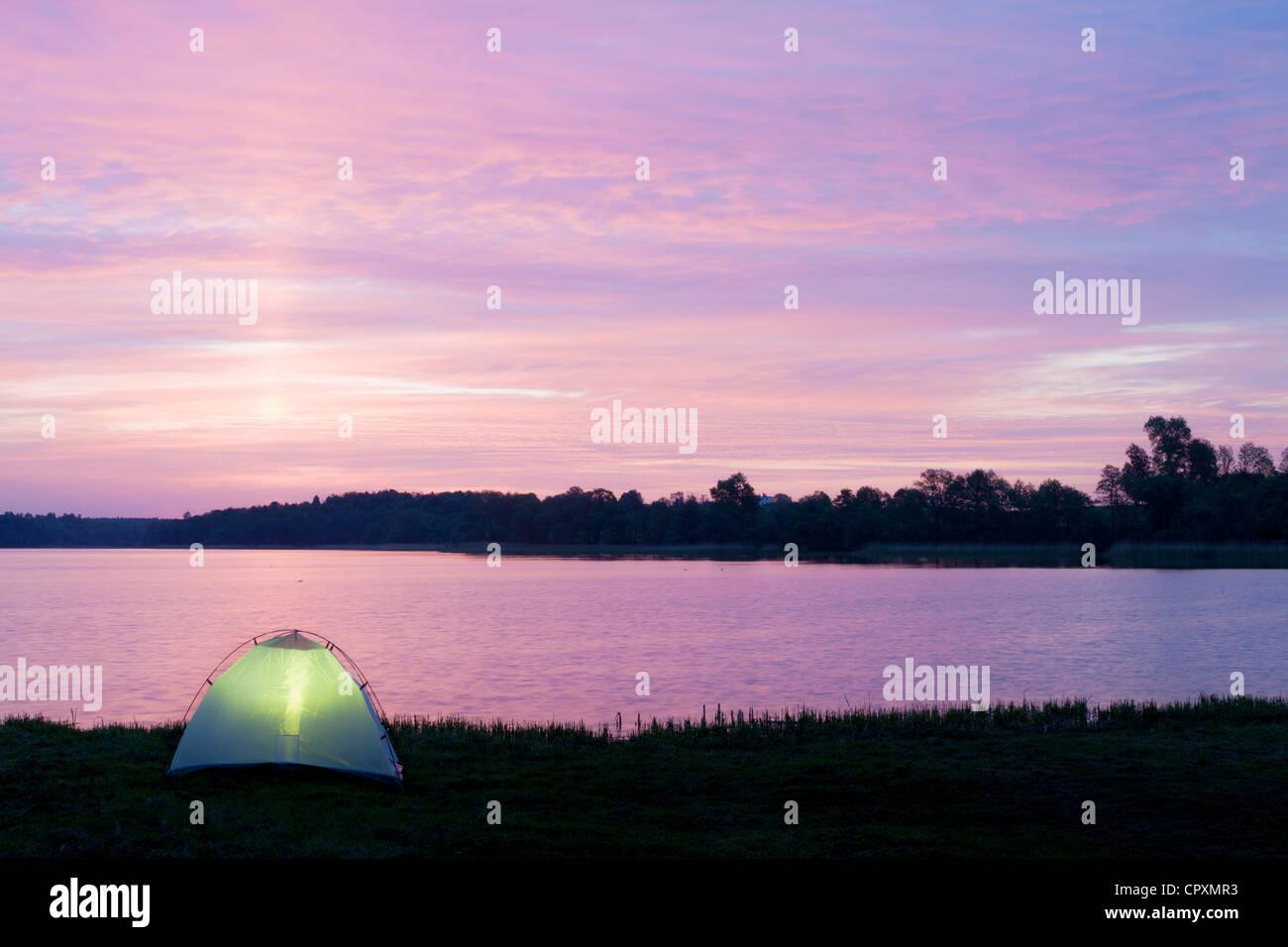 Camping at dawn - Stock Image