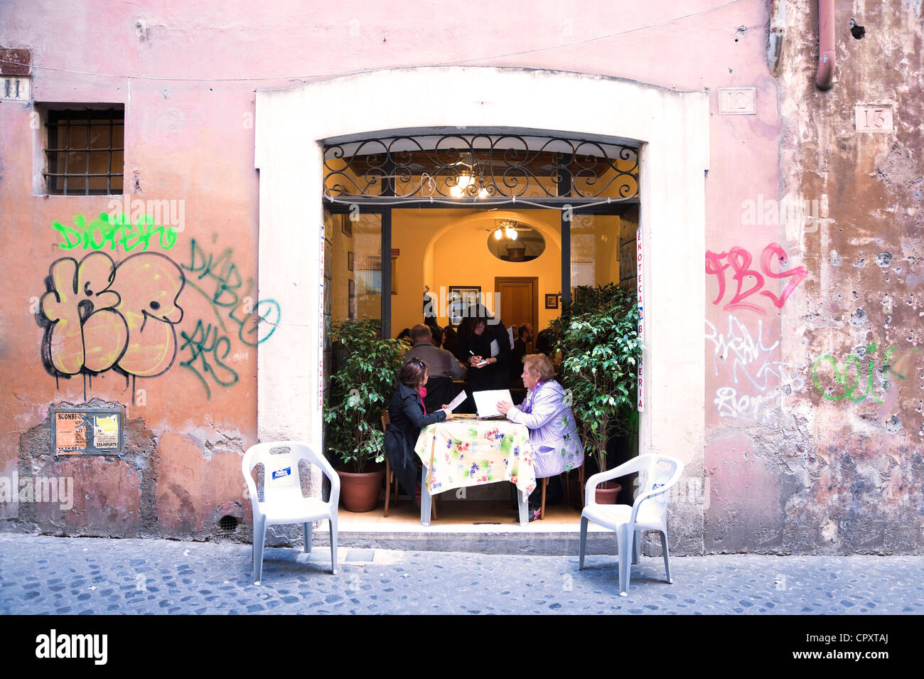two-women-ordering-their-meal-on-a-terrace-in-rome-CPXTAJ.jpg