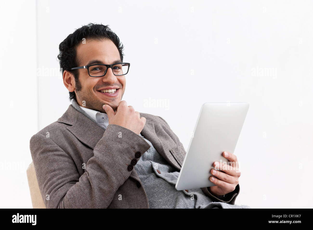 Businessman using tablet computer - Stock Image