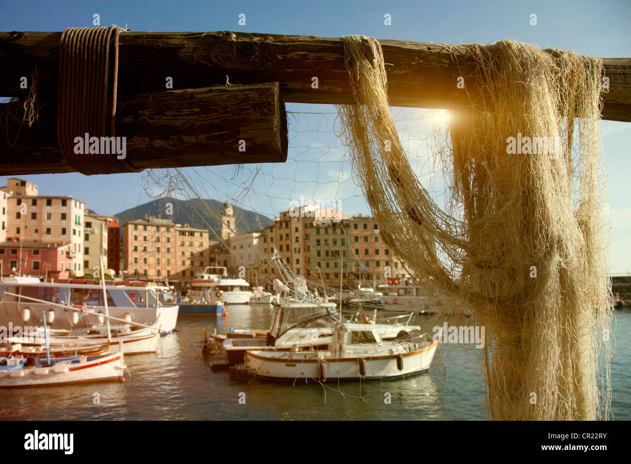 Netting hanging on rail at pier - Stock Image