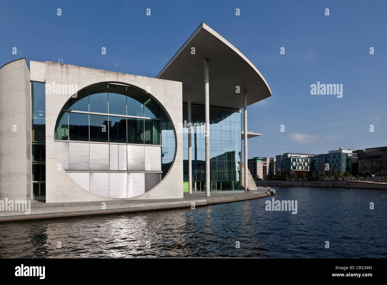 Modern building on urban canal - Stock Image