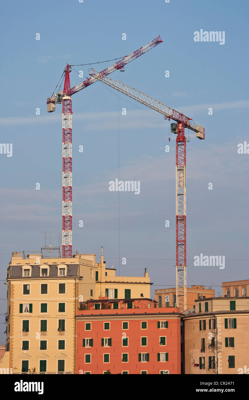 Cranes over urban apartment buildings - Stock Image