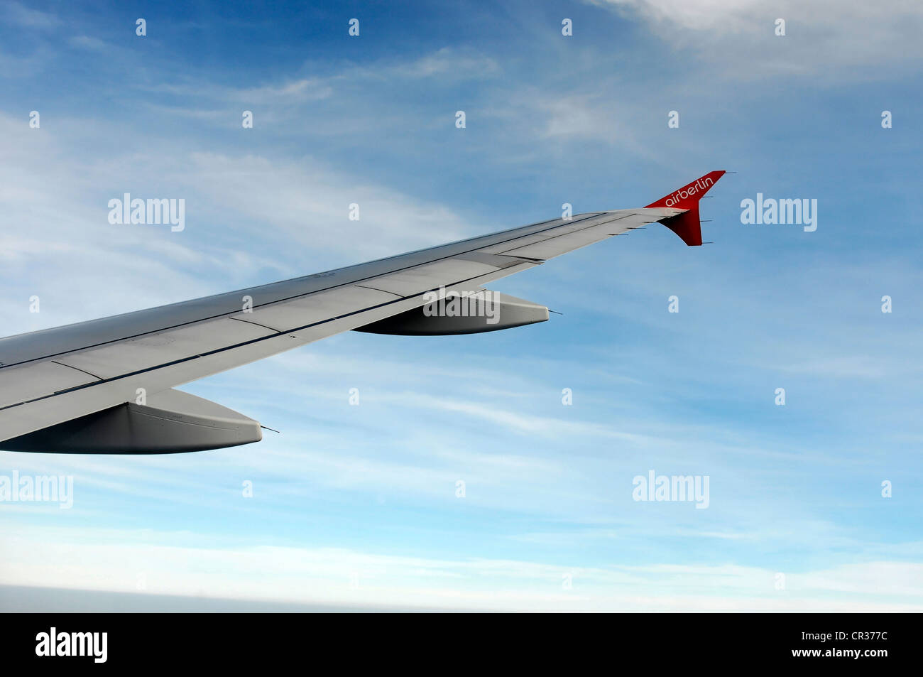 Right wing, Airbus A 319 in flight above clouds - Stock Image