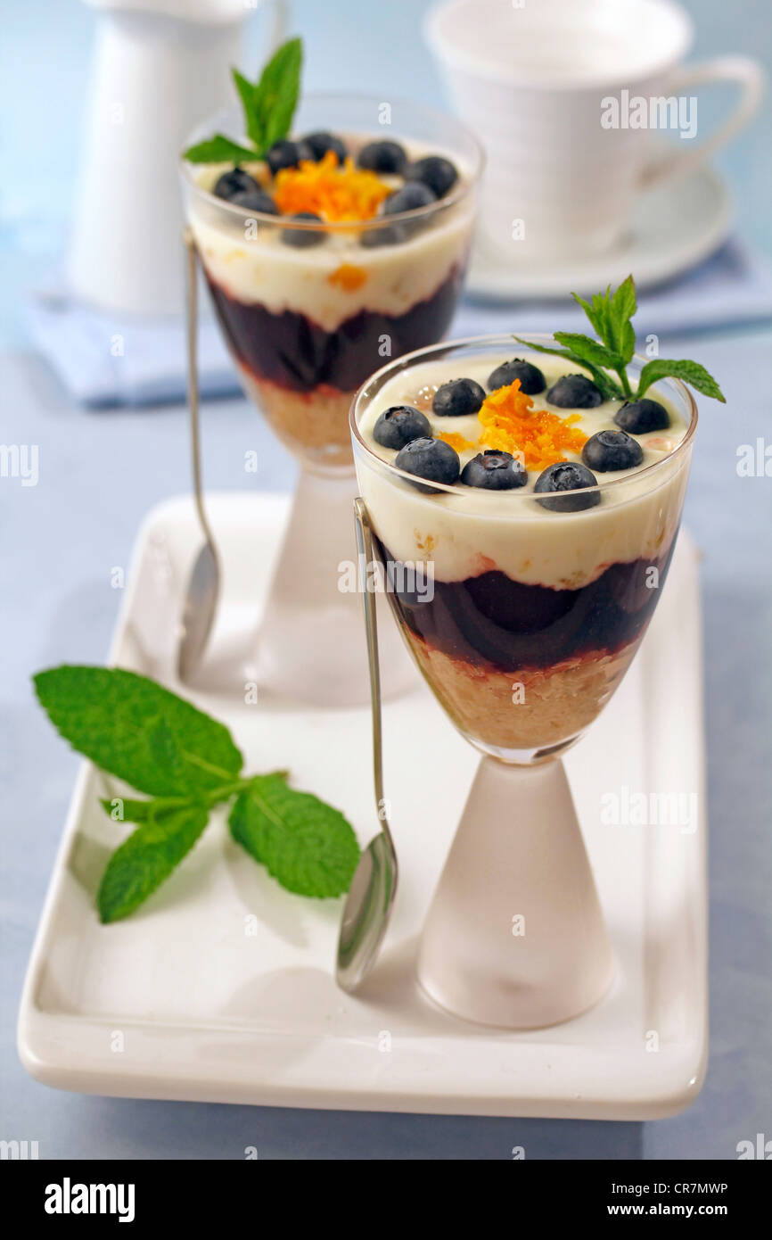 Cup with yogurt, orange and blueberries. Recipe available - Stock Image