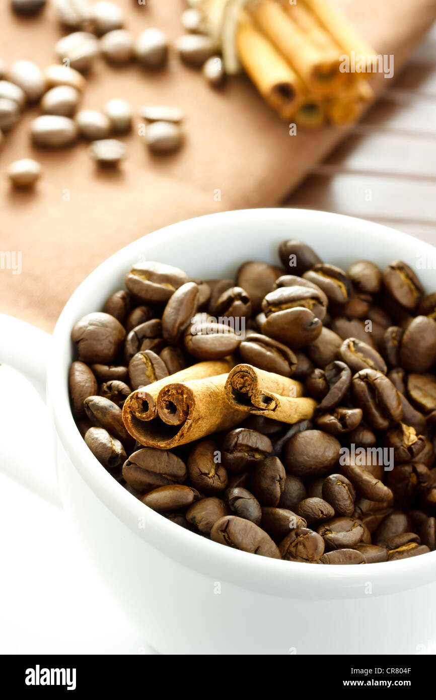 Coffee beans and Cinnamon Sticks in the cup - Stock Image