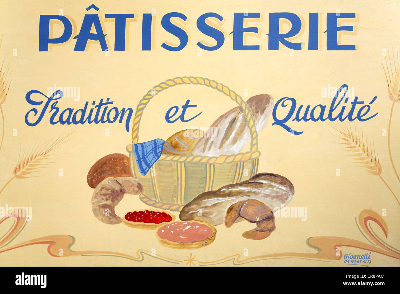 Painted advertising sign of a French patisserie, confectionery, Hyères-les-Palmiers, Provence-Alpes-Côte - Stock Image