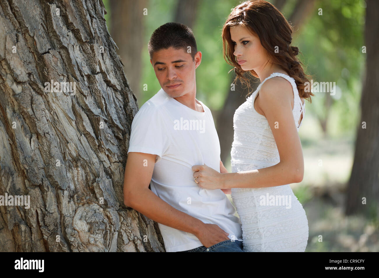 Young couple having communication issues outside in the woods Stock Photo