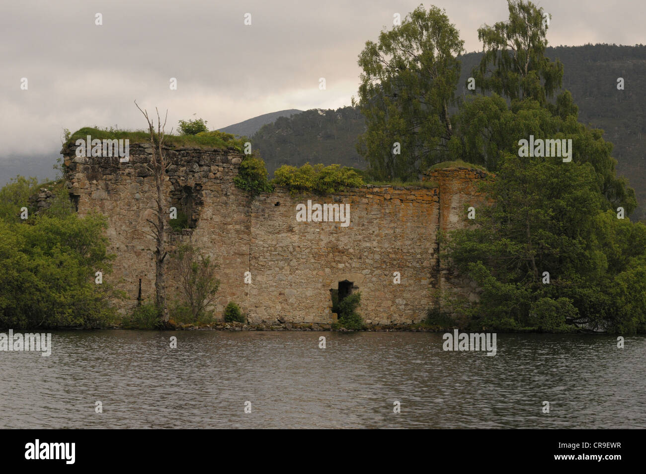 Castle in the middle of the loch at Loch an Eilein, Scotland. - Stock Image