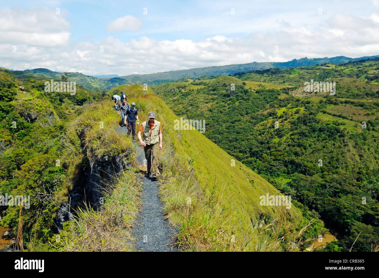 Hikers on Paso del Angel, a narrow pass in Santa Sofia, Villa de Leyva, Boyaca department, Colombia, South America - Stock Image