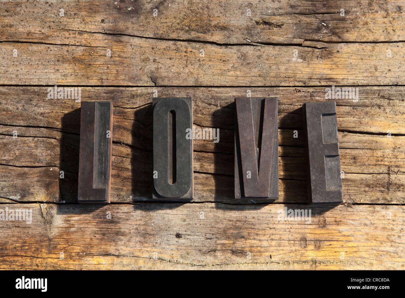 Wooden blocks spelling love - Stock Image