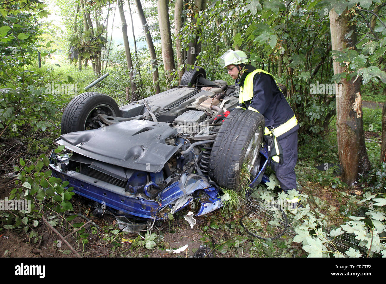 Firefighter attending a car wreck after an accident on the A48 Autobahn, motorway, Hoehr-Grenzhausen, Rhineland - Stock Image