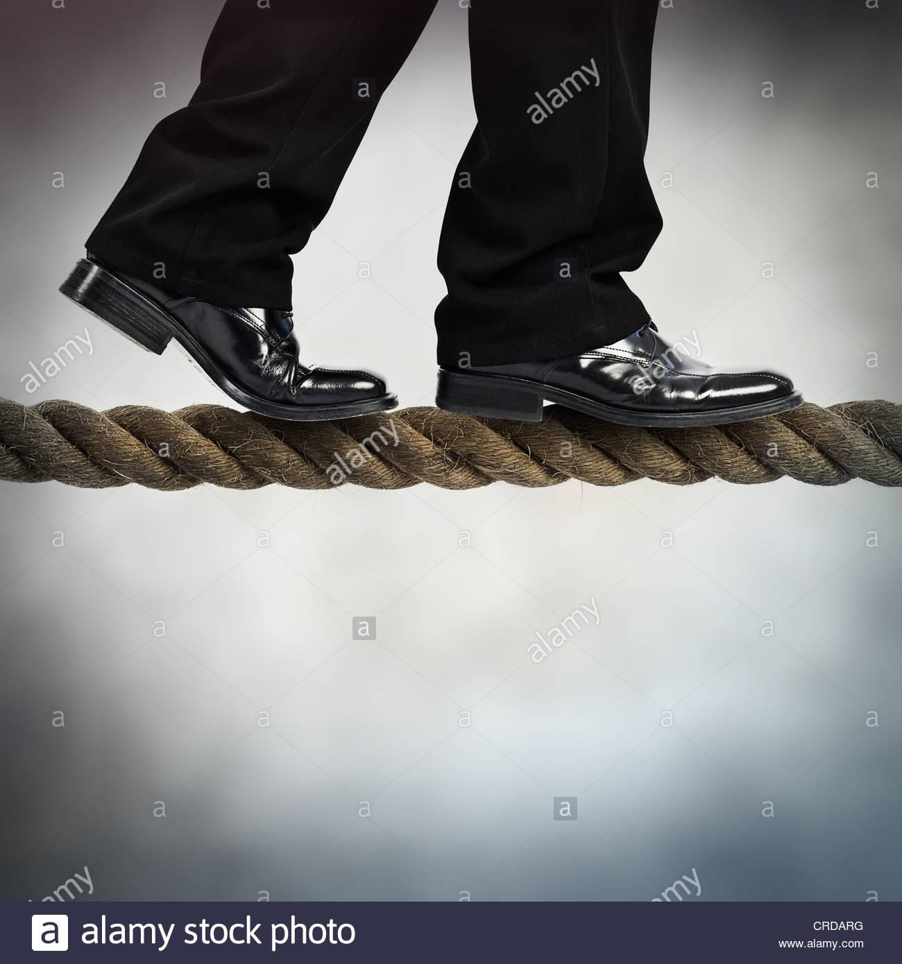 tightrope walk - Stock Image