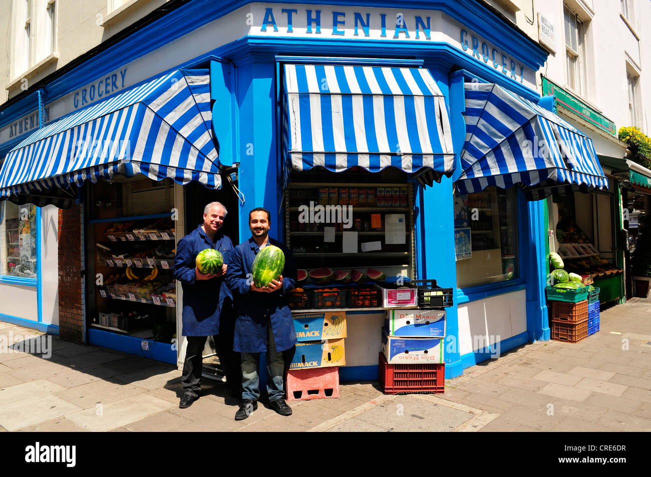 Shopkeepers at the Greek Cypriot Athenian Grocery, near Notting Hill,  London, UK