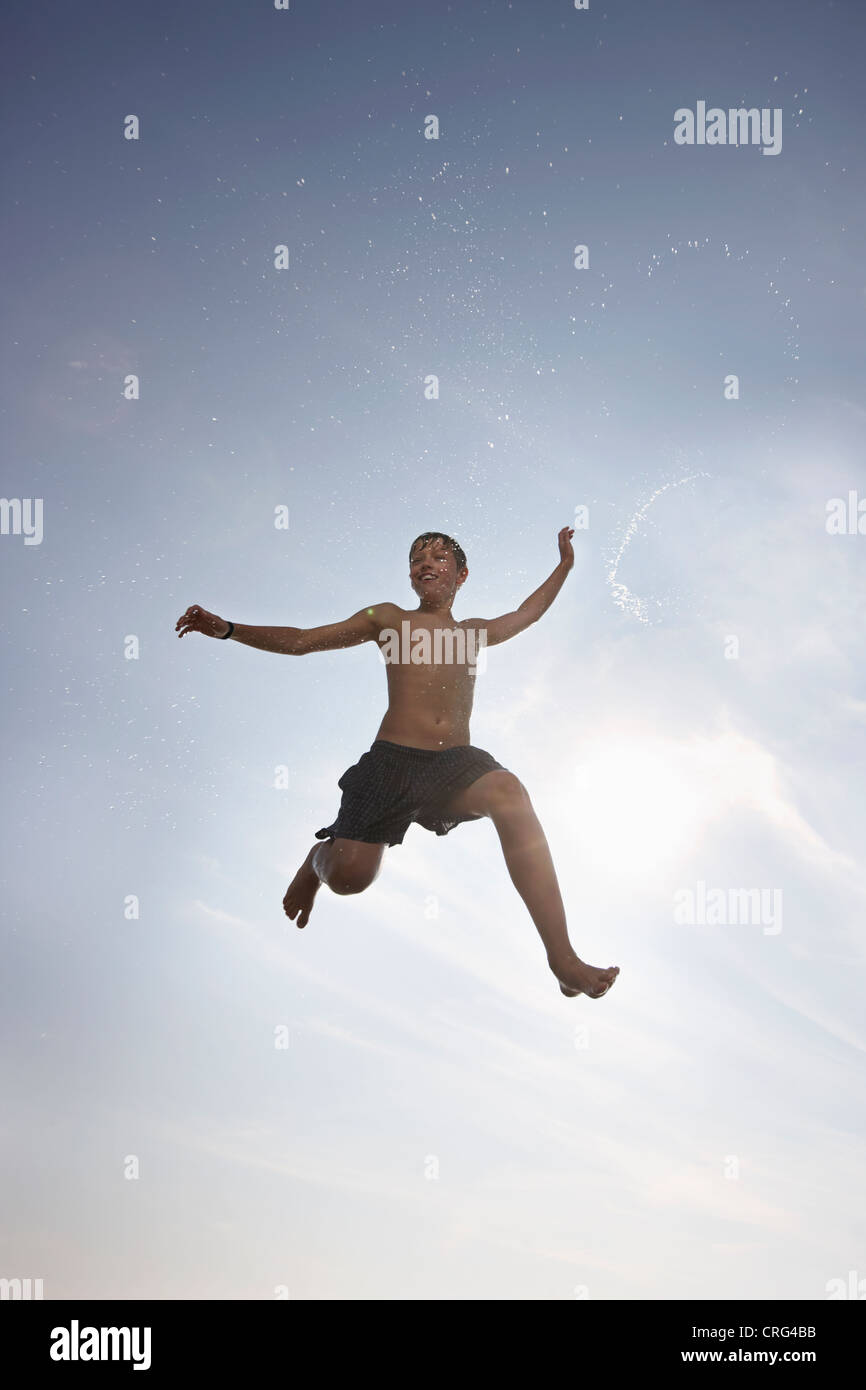 Boy posing in mid-air - Stock Image