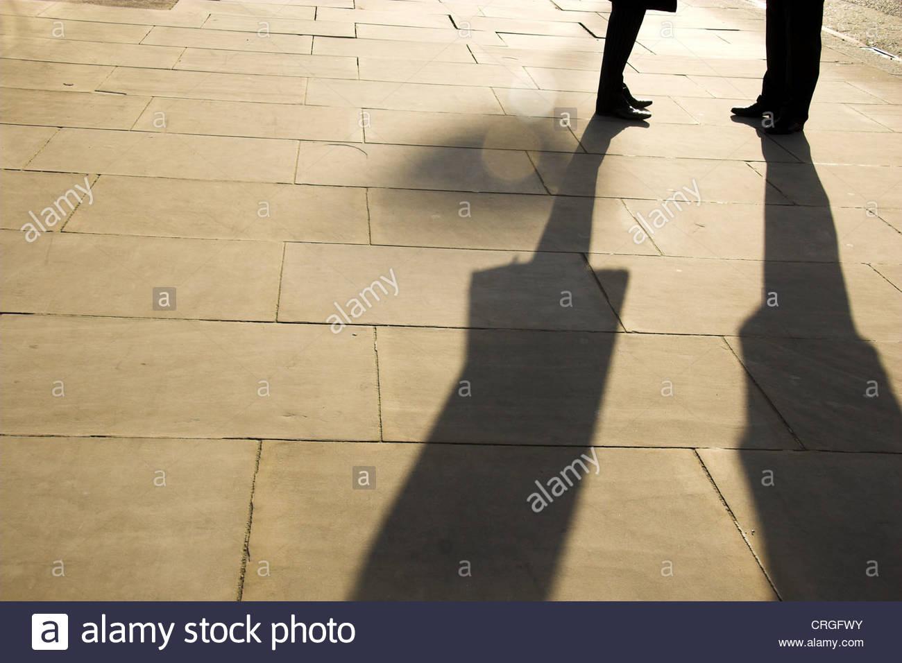 two-people-meeting-in-the-street-in-london-uk-CRGFWY.jpg