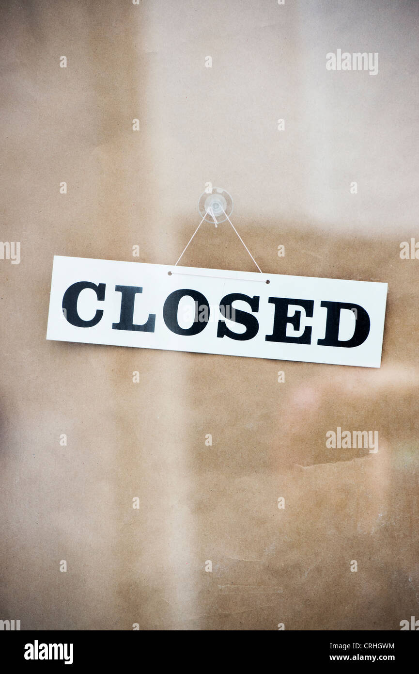 Closed sign on a shop door. UK - Stock Image