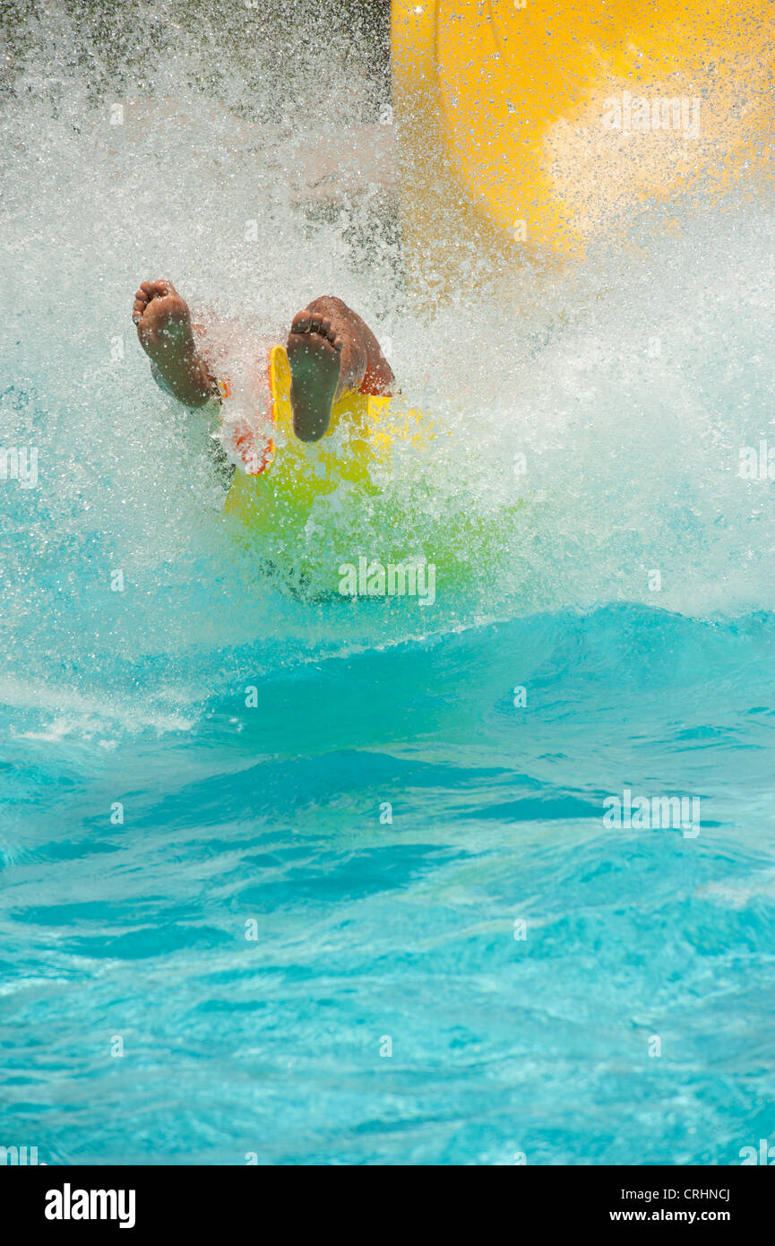 Person Having Fun In The Summer Coming Down A Long Water Chute   Stock Image