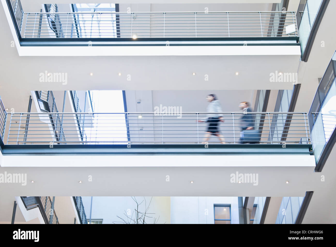 Blurred view of business people - Stock Image