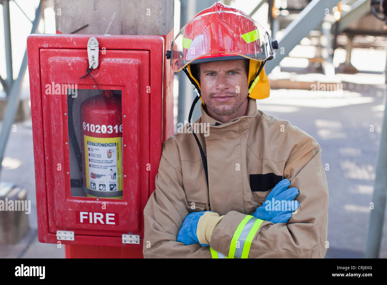 Firefighter smiling on site - Stock Image