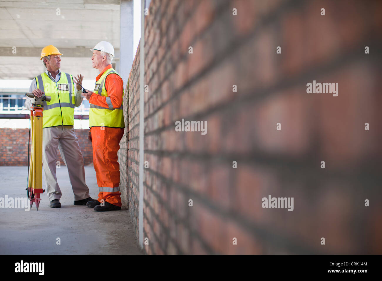 Workers talking at construction site - Stock Image