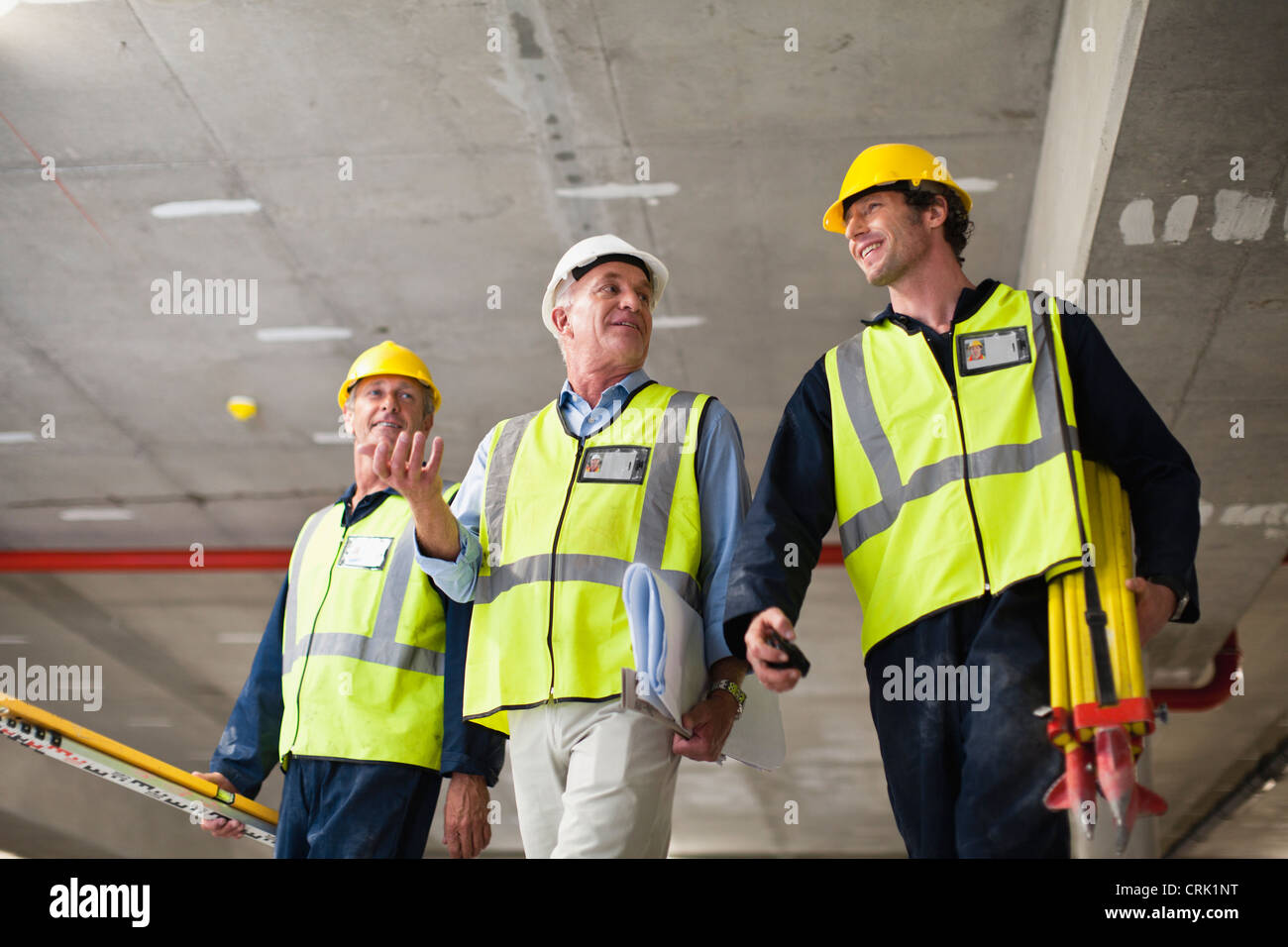 Workers walking at construction site - Stock Image