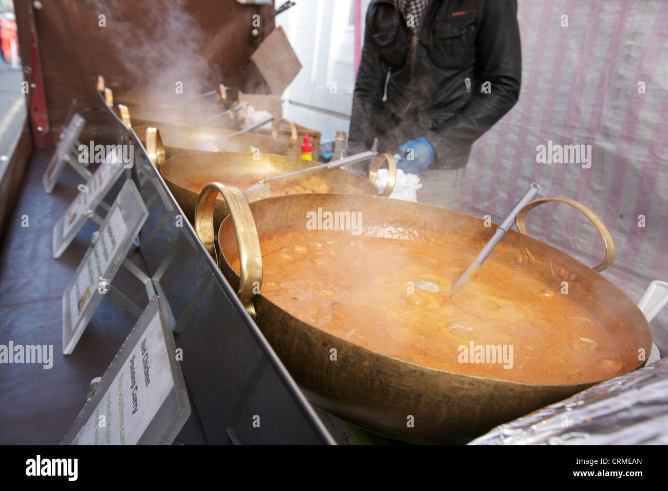 Midsection of a young man cooking Thai food at street stall - Stock Image