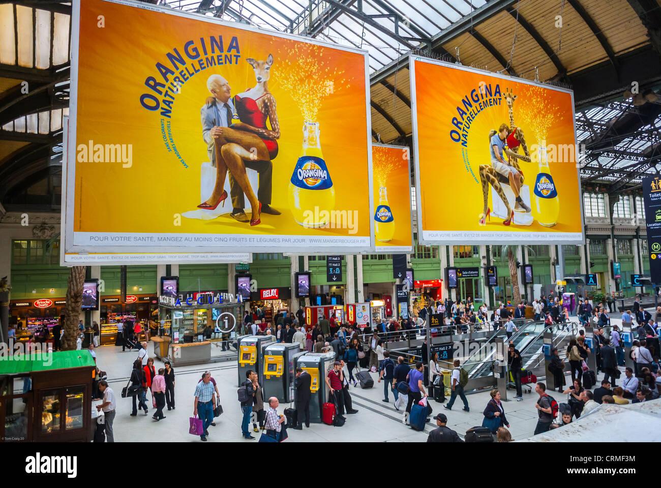 "Paris, France, French Soft drink Advertising Billboards in Train Station, ""Gare de Lyon"", Orangina (Coca Cola) Stock Photo"